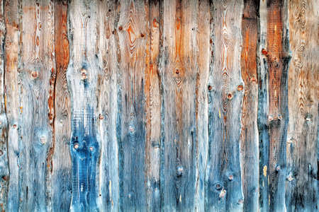 Old pine wood texture background for long periods of time outdoors and in the sun