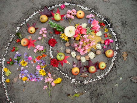 Magic spiral works next to a lake, wicca altar. Stock Photo