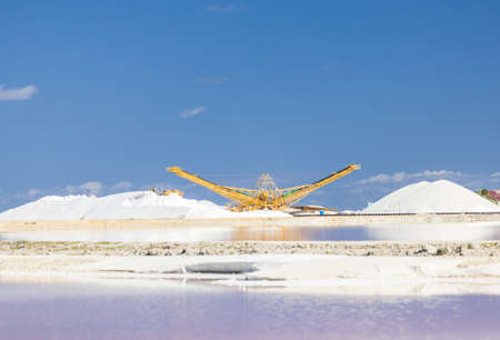 Salt flats in Bonaire (netherlands antilles). Salt pyramids and highly salinated red water. Stock Photo