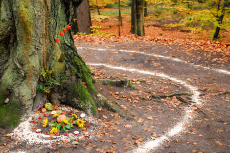 Pagan altar and spiral works outside next to a tree. Wicca and witchcraft. Stock Photo
