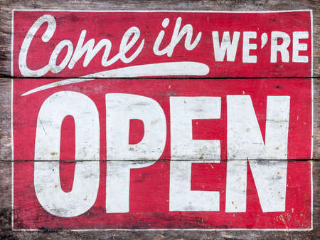 Come in were OPEN - handpainted sign on wood, old. No background. Banco de Imagens