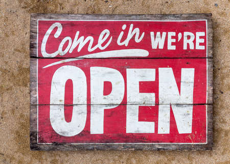 Come in were OPEN - handpainted sign on wood, old Banco de Imagens