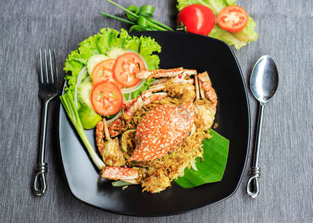 Fried rice with crab on dish with spoonCrab fried rice with curry powder,onionKao pad pooTop view crab fried rice Stok Fotoğraf