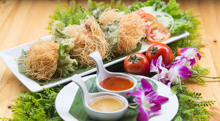 Shrimp sarong Thai food Deep fried shrimp wrapped with noodle Shrimp sarong decorated in a dish ready to serve Stok Fotoğraf