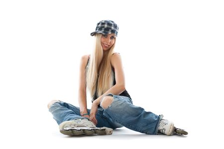 roller skate: Caucasian woman sitting with rolls on legs. Cap on head, Isolated over white background.