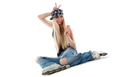 rollerskater: Caucasian woman sitting with rolls on legs. Cap on head, Isolated over white background.