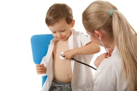Medical examination 3-4 years boy. Caucasian child,  female nurse with stethoscope. photo