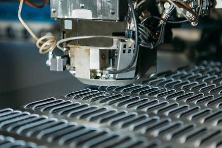 aluminium: close up of cnc punching press machine with metal plate