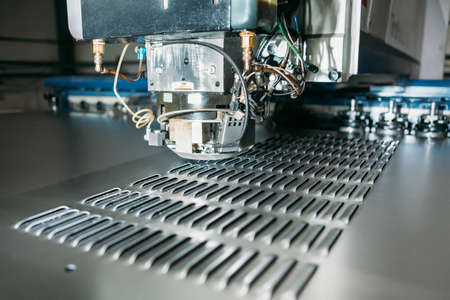 aluminum: close up of cnc punching press machine with metal plate