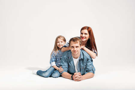 Happy funny family portrait lying on white background isolated