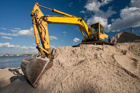 dredger: Yellow dredger machine excavating sand Stock Photo