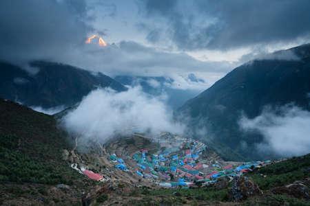 sherpa: View to sherpa capital Namche Bazar at sunset, Nepal Stock Photo
