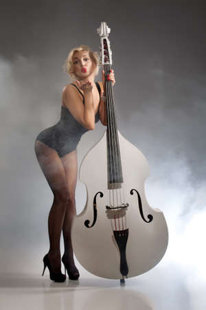 panty hose: Young woman in a black underwear with a double bass