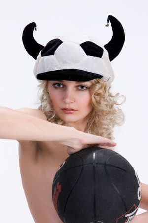 fanatic studio: Young attractive blonde woman ina fan hat holding a ball