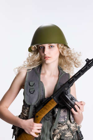 militaire sexy: Young blonde woman dressed in military style with weapon
