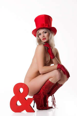 sex appeal: Young nude woman in red boots on isolated background