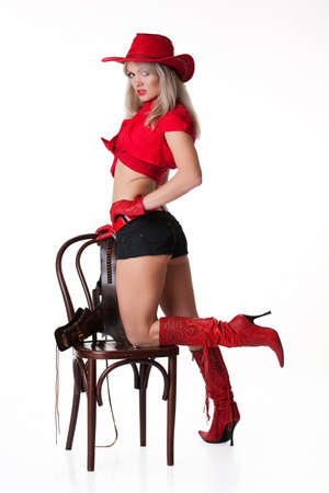 sex appeal: Young woman in red hat and boots on isolated background