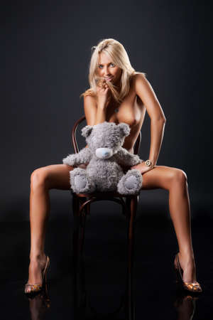 nude blonde woman: Young nude blonde woman sitting on bent-wood chair