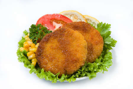greenery: Cutlets with greenery, lemon, tomatoes and peas