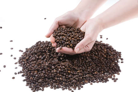 womans hands: Womans hands and coffee beans Stock Photo