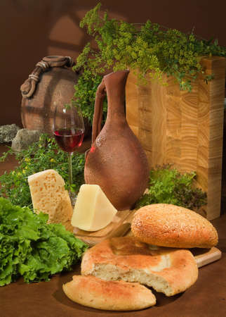 wooden basket: Still life with bread and ceramic jar