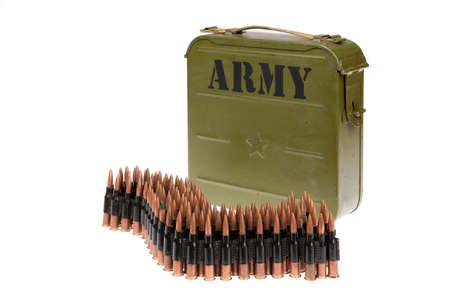 machine-gun: Metal belt with machinegun cartridges on isolated background
