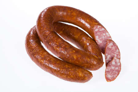 sausage pot: Piece of sausage on isolated background