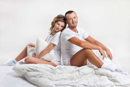 attractiveness: Young beautiful woman and man in lingerie with toys and home accessories
