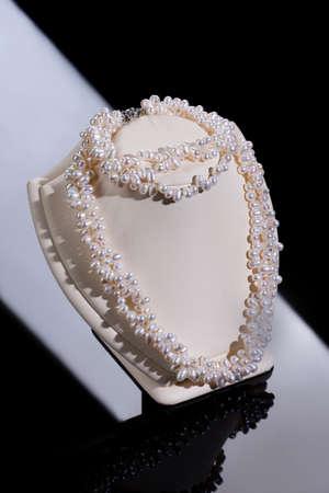 diamonds on black: Beads, pearls, jewelry Stock Photo