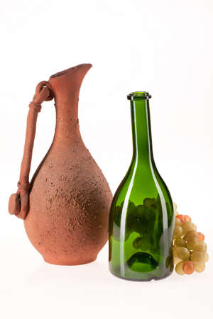 ceramic bottle: Ceramic pot, glass bottle and bunch of grapes on isolated background