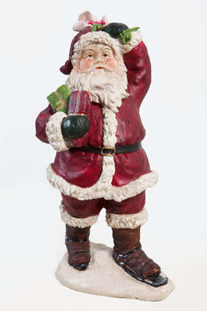 klaus: Old fashioned handmade statuette of Santa Klaus on isolated background