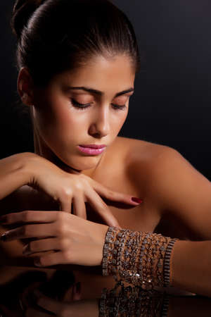 sex appeal: Young beautiful woman with bracelets on her hand Stock Photo
