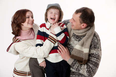 family isolated: Young woman, man and boy on isolated studio background