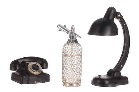 ebonite: Old phone, the lamp and siphon on isolated studio background