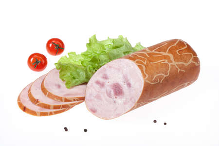 greenery: Isolated sausage with greenery on a white studio background Stock Photo