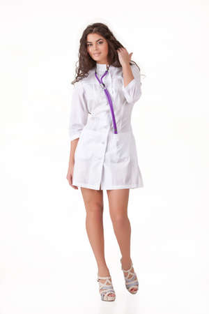 phonendoscope: Young woman in the medical uniform