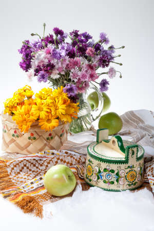 tableware life: Flowers and Russian national artworks on an isolated studio background