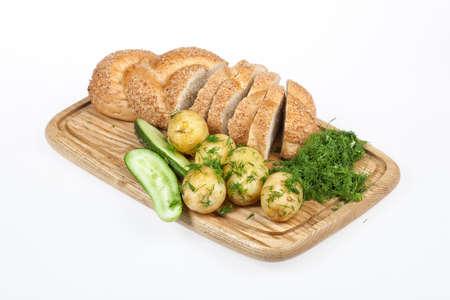 greenery: Potatoes, greenery and tableware on isolated satudio background