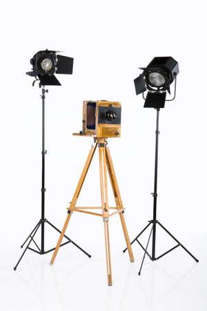 barndoor: Old wooden photocamera and lighting