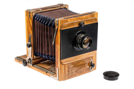 Old wooden photocamera on an isolated studio white background