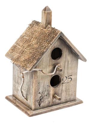 nestling: Wooden nestling box on an isolated studio white background