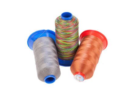 silk thread: Bobbins with silk thread on an isolated studio background