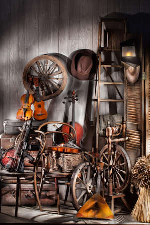 cellos: Still life with old musical instruments, chairs and spinning wheel
