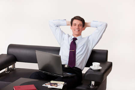 refle: Young businessman working at the computer on isolated background Stock Photo