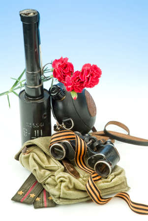 Flowers and army equipment on a studio background Stock Photo