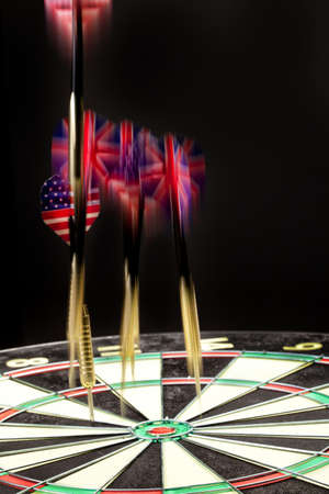 Indoor game Darts on a black studio background Stock Photo