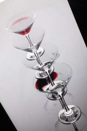 Glass with a red wine on a glass studio background Stock Photo