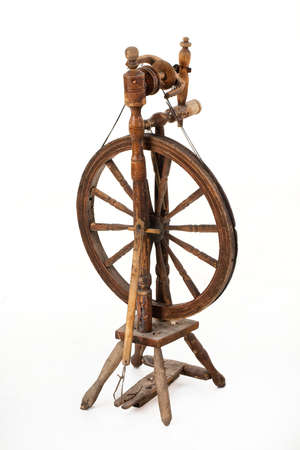 Old spinning wheel on an isolated studio background Stock Photo