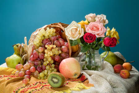 Wicker basket, ceramic vase and fruits on a studio background Stok Fotoğraf