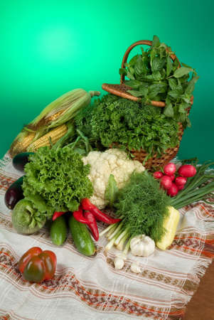 Wicker basket and vegetables on a studio background